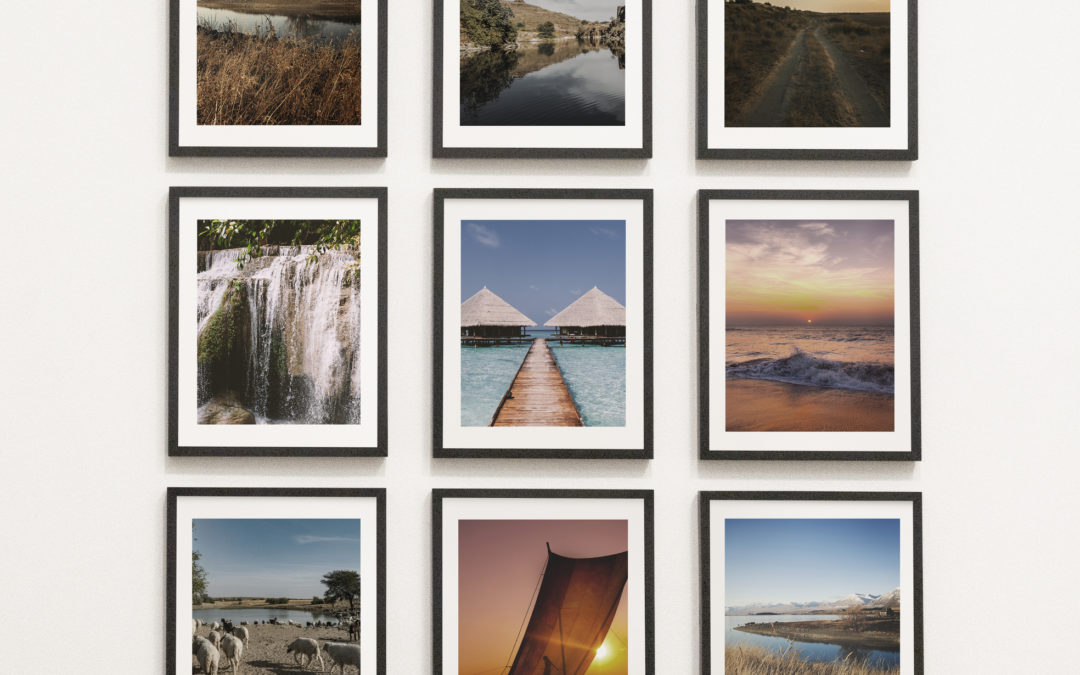 3 rows of scenic photos on a wall in black frames